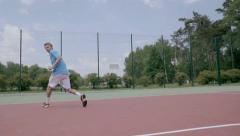 Between the legs trick tennis shot. Slow Motion Stock Footage