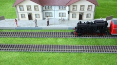Model train station: riding a freight train and a passenger. Stock Footage
