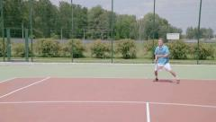 Aggressive baseliner use forehand and backhand shots. Slow motion - stock footage