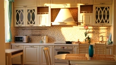 The sun is shining from a window in a modern kitchen. Time lapse. Stock Footage