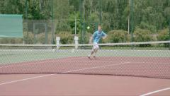 Tennis player hit a drop shot. Ball softly falls just after the net. Slow motion - stock footage