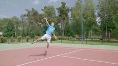 Tennis overhead jump smash. Spectacular  shot in slow motion Stock Footage