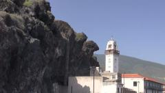 Lava rocks and a church at Candelaria, Tenerife, Canary islands, Spain Stock Footage