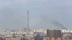Ostankino TV tower and a residential area with fire. Stock Footage