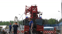 Men ready fire engine with crane on territory of fire station. Stock Footage