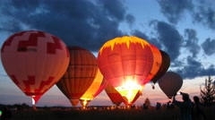 Several air balloons begin to rise into the air - stock footage