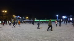 People ride in the evening at the rink in Sokolniki. Stock Footage
