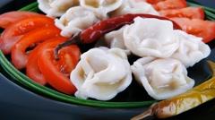 Dumplings served on black plate Stock Footage