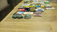 Hand laid out on a wooden table collection of magnets. Stock Footage