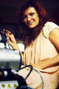 A young woman painting with airbrush equipment and airbrush gun - stock photo