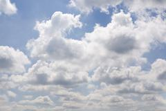 Beautiful white fluffy clouds Stock Photos