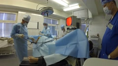 The operating operate a knee of patient in the CELT Stock Footage