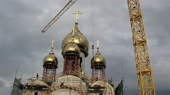 Crane working near the construction of the church Matrona of Moscow Stock Footage