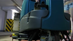 Two girls posing around machine cleaning floor. Stock Footage