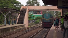 the train arrives at the railroad station - stock footage