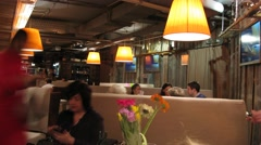 People dine in the art-cafe Rukav, camera rotate. Stock Footage