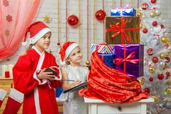 Santa Claus helper and collate a list of gifts Stock Photos