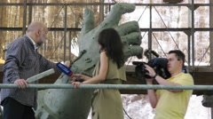 Sculptor gives interviews about sculpture to Prince Vladimir Stock Footage