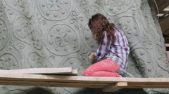 Close-up of girl working on a sculpture to Prince Vladimir Stock Footage