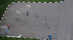 Children skate, ride bicycles in the yard in Moscow Arkistovideo