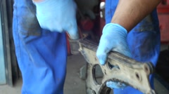 Worker cleaned with sandpaper a piece of metal 16 Stock Footage