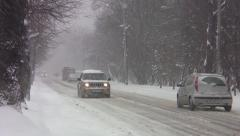 Cars that circulate in winter conditions on a road with snow 74 Stock Footage