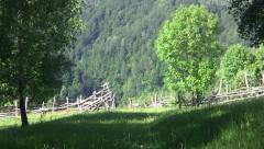 Broken fences at the edge of the border near the dark forest 21 Stock Footage