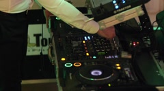 DJ mixes to a private party Stock Footage