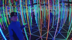 Group of people move in a bright led maze, Moscow. Stock Footage