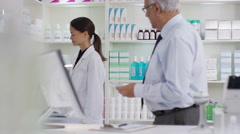4K Portrait of friendly smiling worker in a chemist shop - stock footage