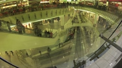 People moving on escalators in a mall Troyka, Auchan. Stock Footage