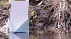Blue paper boat floating on water 101 Stock Footage