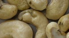 Cashew nuts extreme macro view spinning loop Stock Footage