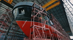 Ship is under construction at a dock Stock Footage