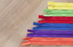 Zippers wooden background Stock Photos