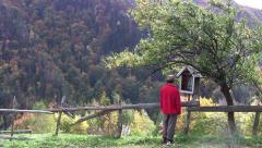 Man approaching a the wayside crucifix and a prayer 26 Stock Footage