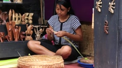 Girl make baskets for balinese gods in a temple, Bali, Indonesia Stock Footage