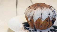 Cake dusted with coconut sprinkled with cocoa Stock Footage