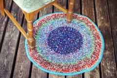 Handmade knitted colorful rug - stock photo
