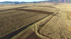 Autumn Agricultural Field with Road. Stock Footage
