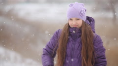 The girl in a winter fur cap speaks by phone outdoor - stock footage