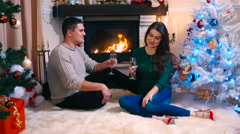 Stock Video Footage of Young family celebrating Christmas in a new home