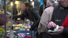 Young woman buys shampoo at market Stock Footage