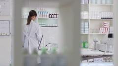 4K Portrait of friendly smiling worker in a chemist shop Stock Footage
