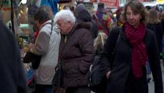 People at local market in Amsterdam Stock Footage