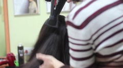Hairdresser dries the hair dryer at the beauty salon. Stock Footage