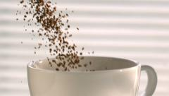 Coffee Pouring into a White Cup in Slow Motion Stock Footage