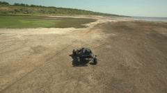 Man on DIY buggy near Hadjibey lake, Odessa. Aerial. Stock Footage