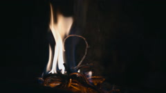 Lighting fire in fireplace - stock footage