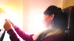 woman in airplane with  mirror and cosmetics - stock footage